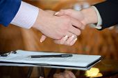 picture of contract  - Businessman and woman hand signing contract paper - JPG