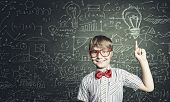 foto of formulas  - Genius boy in red glasses near blackboard with formulas - JPG