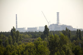 foto of reactor  - Forest and Chernobyl nuclear reactor in the background - JPG
