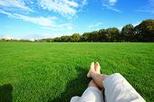 stock photo of barefoot  - Relax barefoot enjoy nature in the green lawn - JPG