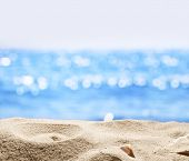 picture of insert  - Sand with blurred sea background - JPG