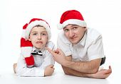 picture of tease  - Humour portrait of father man and son kid child in Santa - JPG