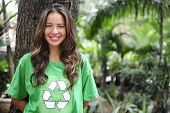 foto of environmental protection  - young environmental activist in the forest wearing a green recycle t - JPG