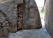 stock photo of grotto  - View from a grotto in the ancient Armenian temple complex Geghard - JPG