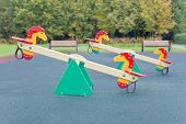 stock photo of seesaw  - Seesaw in the shape of the horses for the playground - JPG