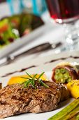 picture of flambeau  - steak with a rosemary leaf with wine - JPG