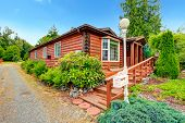 picture of log cabin  - Log cabin style house exterior with curb appeal - JPG