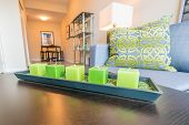 pic of futon  - candles decorating living room with gray sofa - JPG