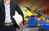 stock photo of loading dock  - working man and container dock in land air cargo logistic freight industry - JPG