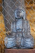 foto of gautama buddha  - An ancient wooden Sakyamuni statue close up thin D - JPG