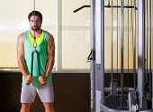 pic of pulley  - Triceps pressdown high pulley workout man at gym exercise - JPG