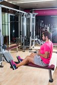 pic of pulley  - seated cable row man rows at gym low pulley machine workout exercises - JPG