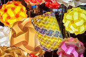 stock photo of lamp shade  - Close up of colorful lamp shades brightly lit - JPG