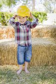 pic of hay bale  - Cute Young Mixed Race Boy Laughing with Hard Hat Outside Near Hay Bale - JPG