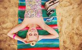 image of hot-water-bag  - happy cute hot body young woman lying on the beach with colorful details relax concept - JPG