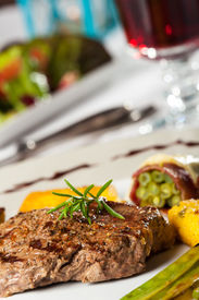 pic of flambeau  - steak with a rosemary leaf with wine - JPG