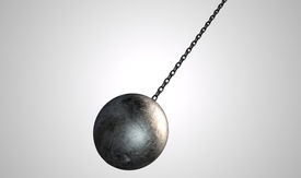 stock photo of ball chain  - A regular metal wrecking ball attached to a chain on an isolated white background - JPG