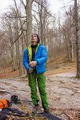 picture of mountain-climber  - The young man in the mountains insures climber - JPG