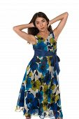 image of petition  - Beautiful petite Eurasian woman in a blue and yellow print dress - JPG