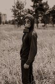 stock photo of gas mask  - Sepia portrait of man in gas - JPG