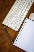 stock photo of field mouse  - A keyboard, mouse, and drawing pad set against an oak wood background ** Note: Shallow depth of field - JPG