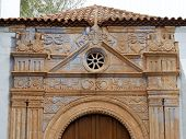 stock photo of panther  - The church of Nuestra Senora de Regla in Pajara in Spain has interesting sculptures of sun pattern snakes panther and birds above the main entrance - JPG