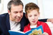 pic of time study  - Happy father and son spending time in reading - JPG