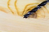 picture of drill bit  - Drill bit close up on wooden plank - JPG