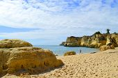 stock photo of peculiar  - Vale Do Olival Beach spectacular cliffs in Portugal - JPG