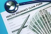 picture of stethoscope  - Health insurance claim form with money and stethoscope for insurance concept - JPG