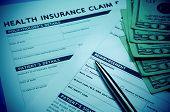 stock photo of reimbursement  - Health insurance claim form with stethoscope for insurance concept - JPG