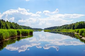 stock photo of grass area  - Forest river landscape with clouds reflection in the water - JPG