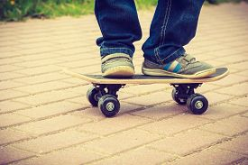 image of skateboard  - Closeup of skateboarder legs - JPG