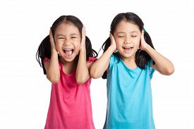 picture of identical twin girls  - Asian twins girls cover their ears isolated on white background - JPG