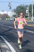 JACKSONVILLE, FLORIDA - MARCH 13: Woman runner Colleen De Reuck, age 45, of Boulder, CO competes in