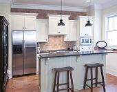 picture of wainscoting  - elegant kitchen with mix of granite - JPG