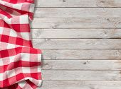 red picnic tablecloth on white wood background poster