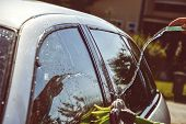 Young Men Washing Silver Car With Pressured Water And Brush At Sunny Day. Close Up Of Cleaning Car O poster