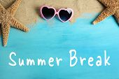 Text SUMMER BREAK, sand and sunglasses on wooden background poster