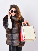 Shopping Or Birthday Gift. Girl Wear Sunglasses And Furry Coat Shopping White Background. Woman Shop poster