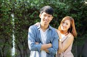 Beautiful Portrait Couple Looking Each Others Eyes And Smiling With Happy, Young Asian Man And Woman poster