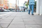 Men Walking On The Sidewalk Alone.men Walking On The Sidewalk Alone. poster