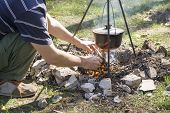 Pot Over The Fire In The Forest. Cooking On A Fire. Spring Camping Concept. Opening Of The New Touri poster