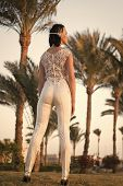 Nice View. Woman Hairstyle Wears Fashionable Tight Fitting Suit With Embroidery And Pearls. Lady Wit poster