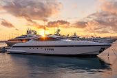 Beautiful Orange Sunset In The Sea Harbor With Moored Yachts. Expensive 92 Foot Yacht At The Pier Du poster
