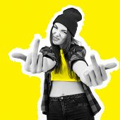 Hipster girl in jeans, checked shirt and hat showing middle fingers over yellow background. Impertin poster