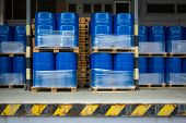 Toxic waste/chemicals stored in barrels at a plant - cans with chemicals, industry oil barrels, chem poster