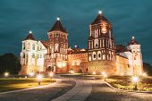 Mir, Belarus. Mir Castle Complex In Evening Night Illumination Lighting. Famous Landmark Under Blue  poster