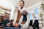 Happy Family Having Fun On Floor Of In Living Room At Home, Laughing, Selective Focus. poster