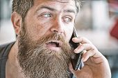 Man With Beard And Mustache Mobile Phone Conversation Defocused Background. Bearded Man Hold Mobile  poster
